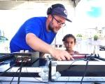 DJ Queasy teaching young DJ Lightning